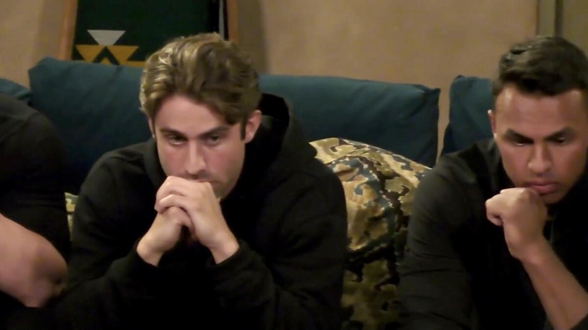 Greg Grippo and Aaron Clancy anxiously sit on the couch with their hands clasped