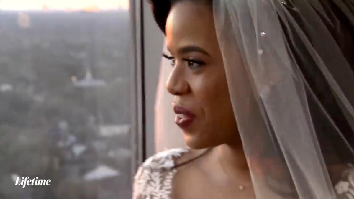 Michaela looks at the view in her wedding dress